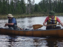 Canoe fishing Father son